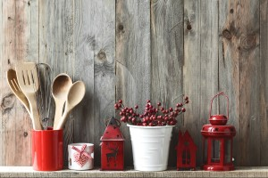 stock-photo-kitchen-cooking-utensils-in-ceramic-storage-pot-and-christmas-decor-on-a-shelf-on-a-rustic-wooden-327210401